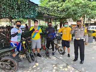 Sasar Komunitas Sepeda Lipat, Satlantas Polres Gowa Edukasi 4 M Tangkal Covid-19.
