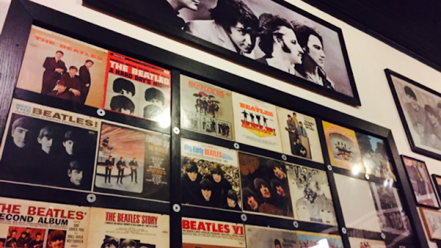 classic Beatles records displayed on the wall