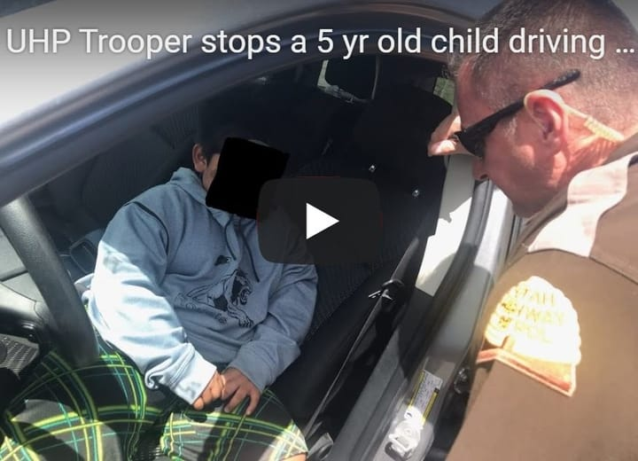 Officers pull over a 5-year-old child driving on the highway.