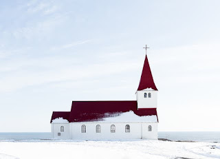church surrounded by snow