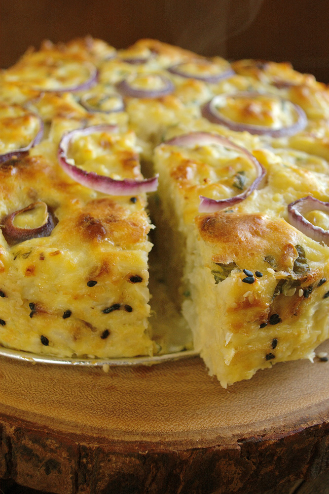 Whatever the question, Cauliflower Cake with Pecorino Romano & Sweet Basil is the answer.