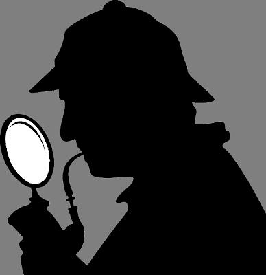 ホームズのような探偵が虫眼鏡を見ている