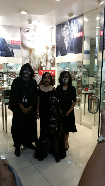 A cute family in Halloween costumes