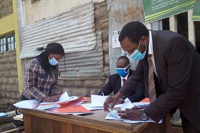 Vincent Makori, 37 charged for biting at Kibera court photo