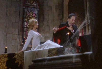 Dracula (Christopher Lee) is repulsed by the silver cross Jessica (Stephanie Beacham) is wearing in Dracula A.D. 1972