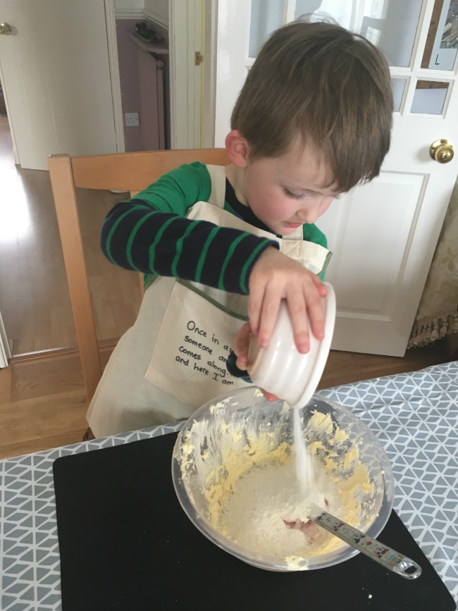 boy-pouring-flour-into-bowl