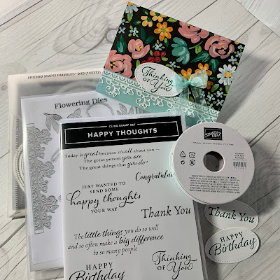 Dies and stamps used to create a floral greeting card