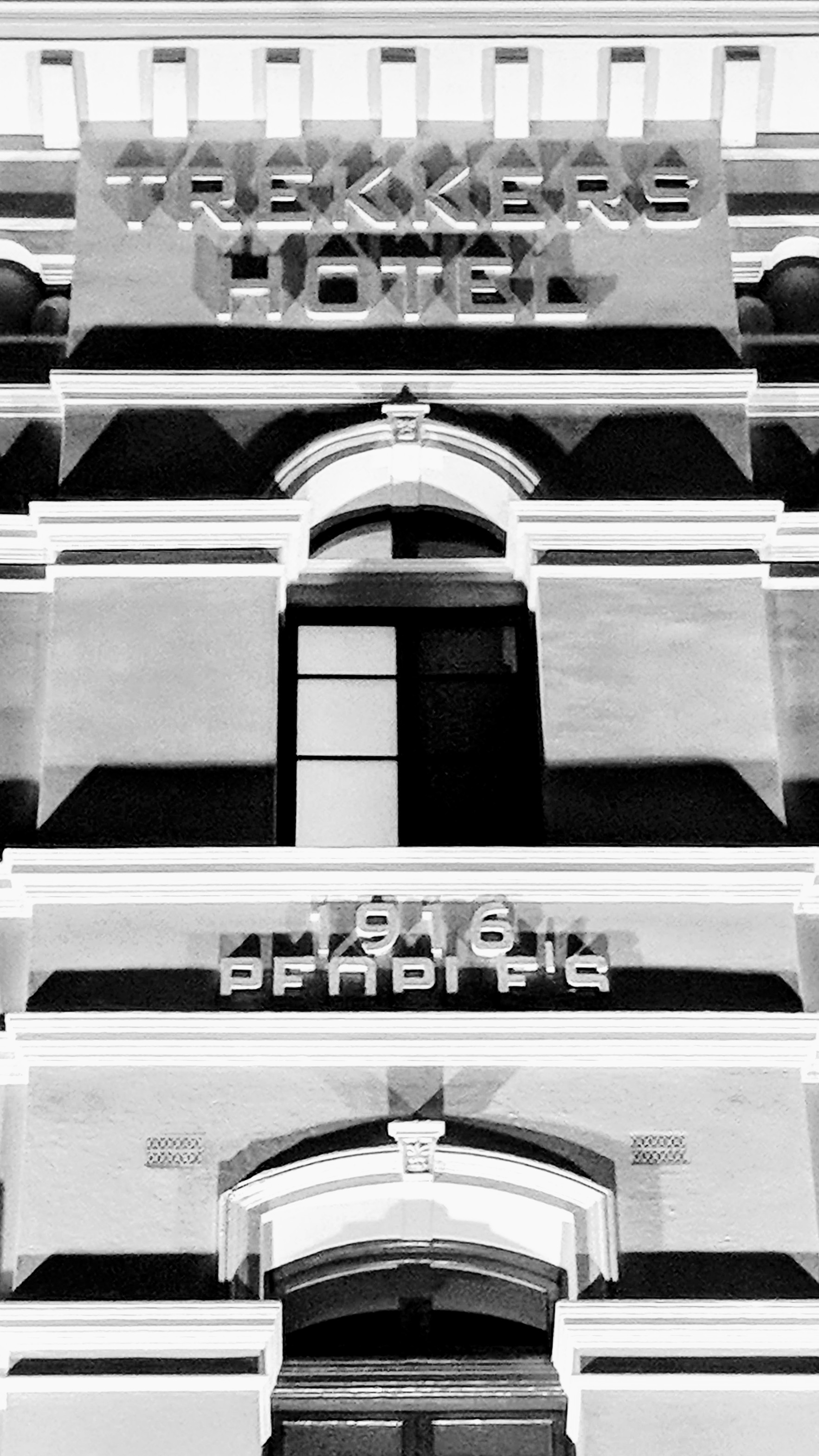 Black and white close-up of the C Hotel facade, Wellington (AoNZ))
