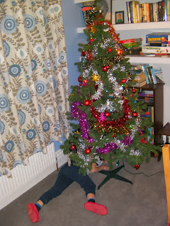 xmas tree with tinsel and baubles