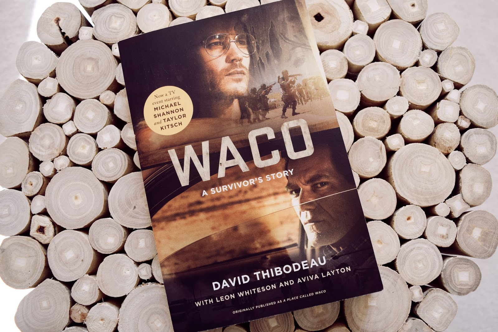 "The book ""Waco: A Survivor's Story"" on a wood table"