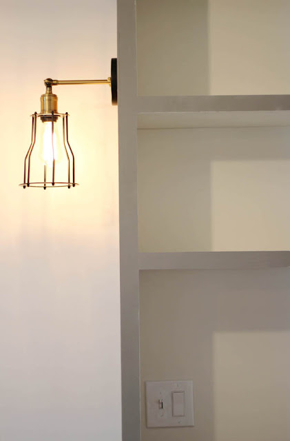 built-ins around bed lighting, sconces, edison bulb, black and gold