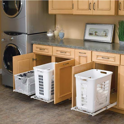 Install pull-out hampers in a bathroom or laundry room