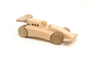 http://www.toyday.co.uk/shop/wooden-toys/wooden-formula-one-racing-car/prod_5467.html