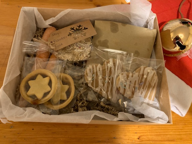 Christmas themed treat box with mince pies, cookies and more