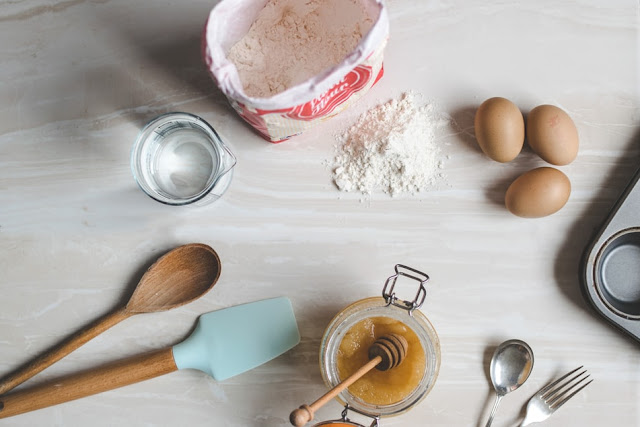 Baking ingredients and utensils laid out and in use