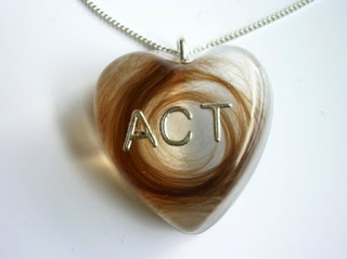 Personalised heart shaped pendant for a lock of hair