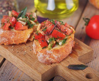 Bruschetta tomato and raw ham