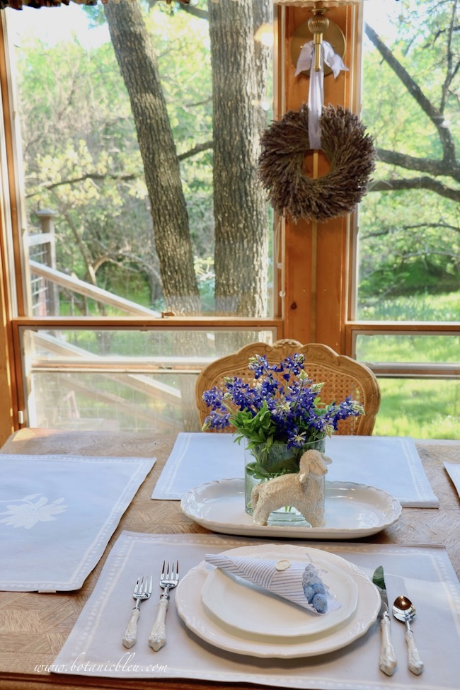 Easter Table With Bluebonnets began with pale blue placemats with a single large white flower