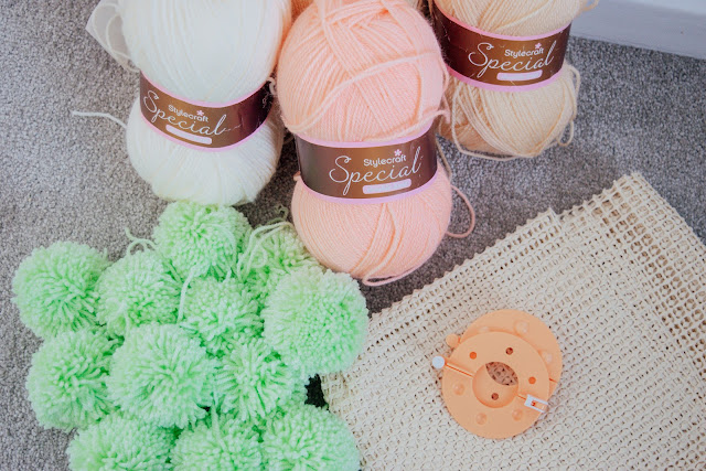 Steins of wool, a non-slip mat and a pom-pom maker