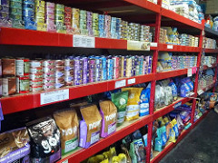 Store shelves filled with variety of Pet Food.