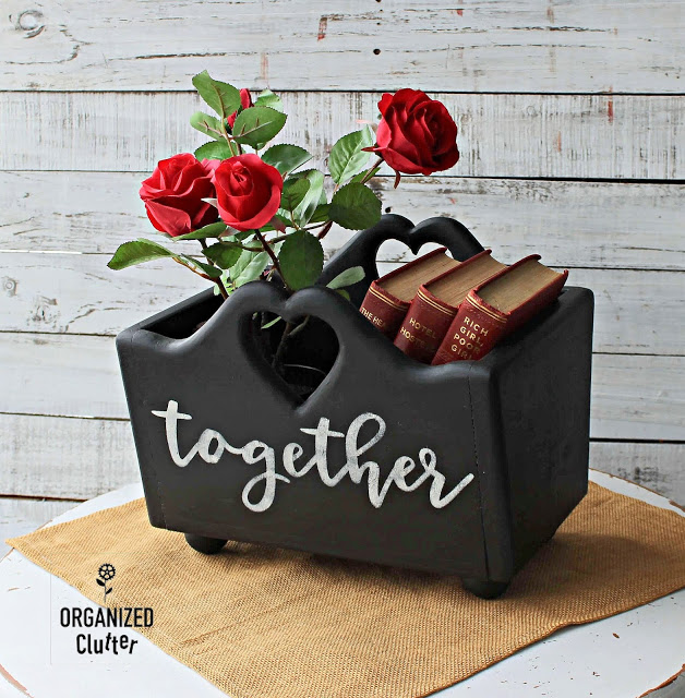 Photo of a heart cutout box upcycled with paint, stencils, and knob feet.