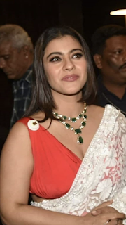 Kajol Devagan latest low cut red sleeveless blouse with transparent saree fashion | Bollywood actress Navel Queens