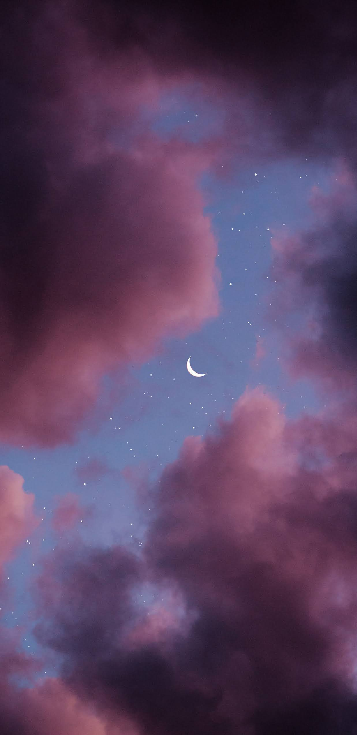 Vầng trăng khuyết trên bầu đầy mây hồng