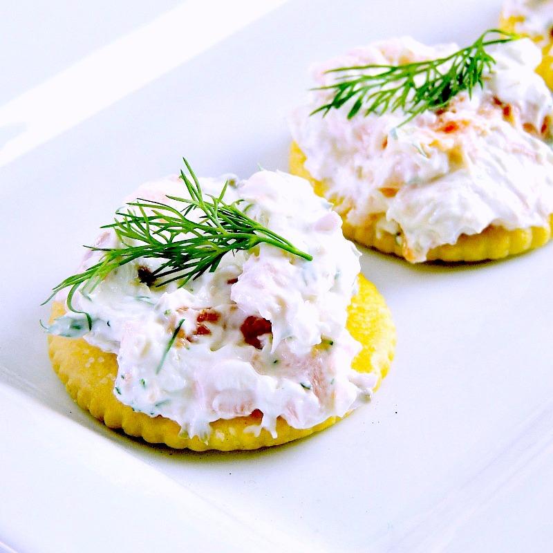 Smoked Salmon Bites, smoked salmon on a Ritz cracker on a white platter