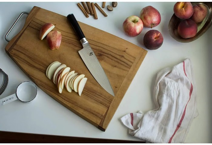 How do you keep the chef's knife blade straight and sharp?