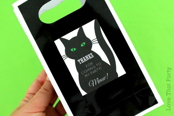 image of black party favor bag with black cat tags. party supplies