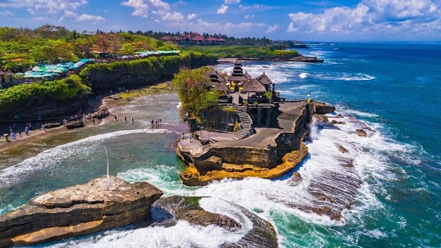 Unique temple on the rock, containing a series of heavenly gates in the middle of Bali sea