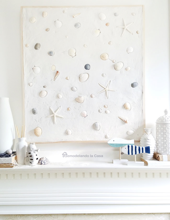 diy seashell wall art on mantel
