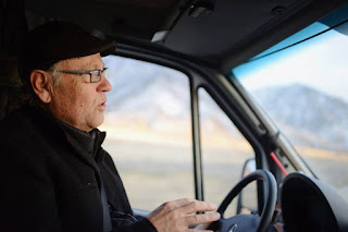 Michael McLean driving truck on tour