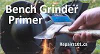 grinding a hatchet on a bench grinder