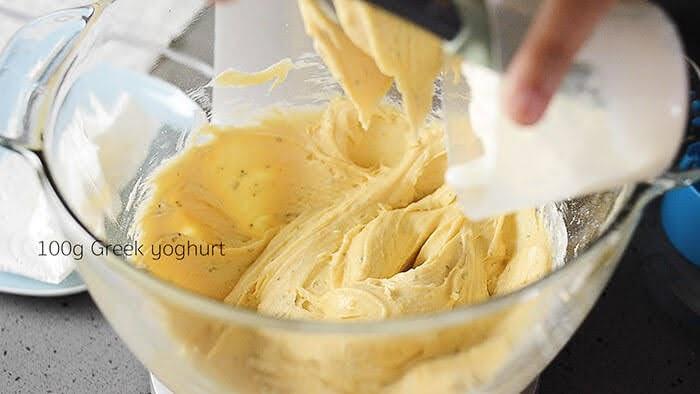 Add yoghurt to kumquat cake batter