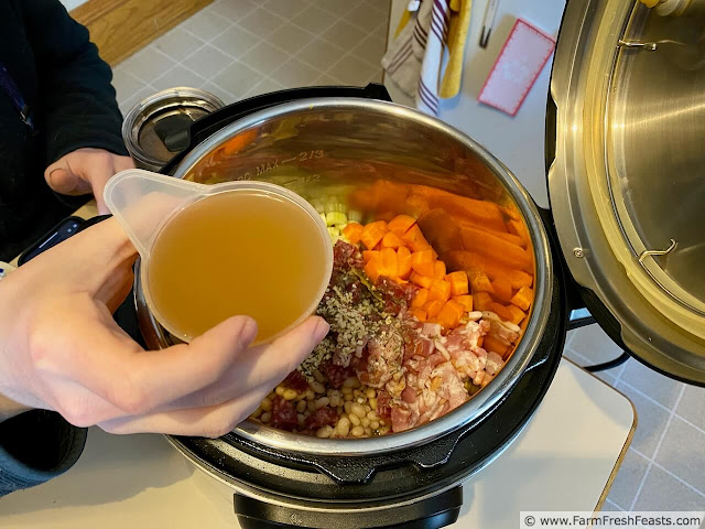Image of broth being added to cassoulet ingredients in the Instant Pot
