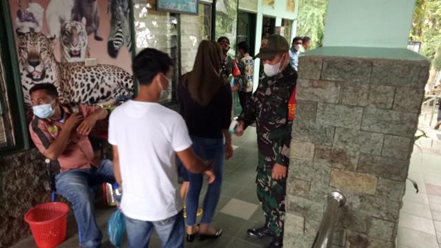 Tepatnya Ditempat Wisata Personel Jajaran Kodim 0207/Simalungun Lakukan PPKM Skala Microso
