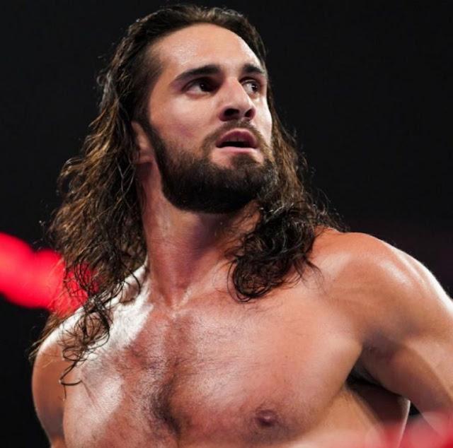 World Heavyweight Champion Seth Rollins looks on before