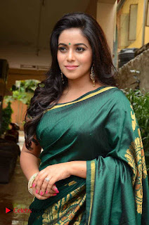 Actress Poorna Latest Pictures in Green Saree at SR Fashion Studio Launch  0002.jpg
