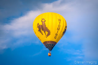 Cramer Imaging's fine art photograph of the Wyoming hot air balloon taking flight in Panguitch Utah with a partly cloudy morning sky