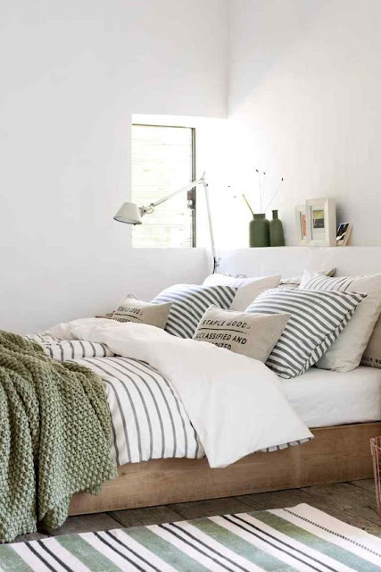 neutral bedroom, striped bedding, green throw