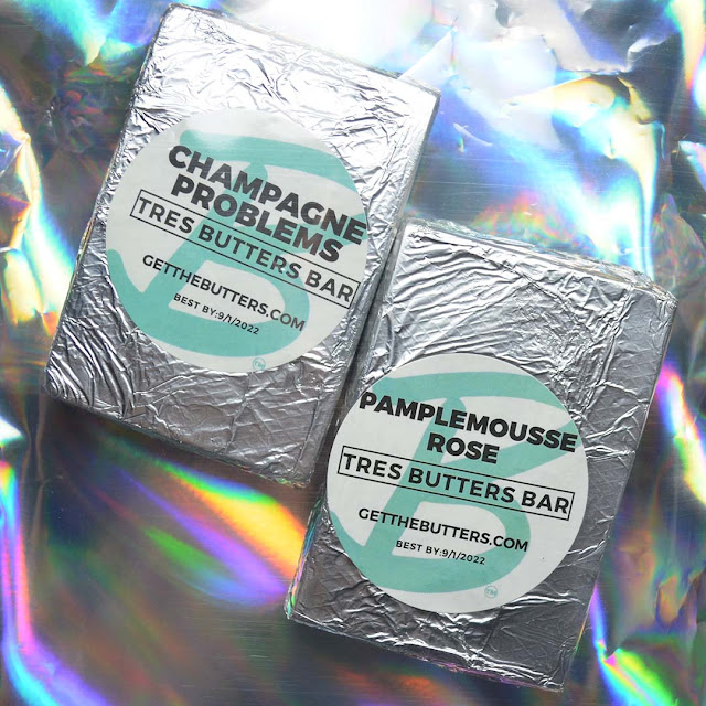 soap bars wrapped in foil against holographic background