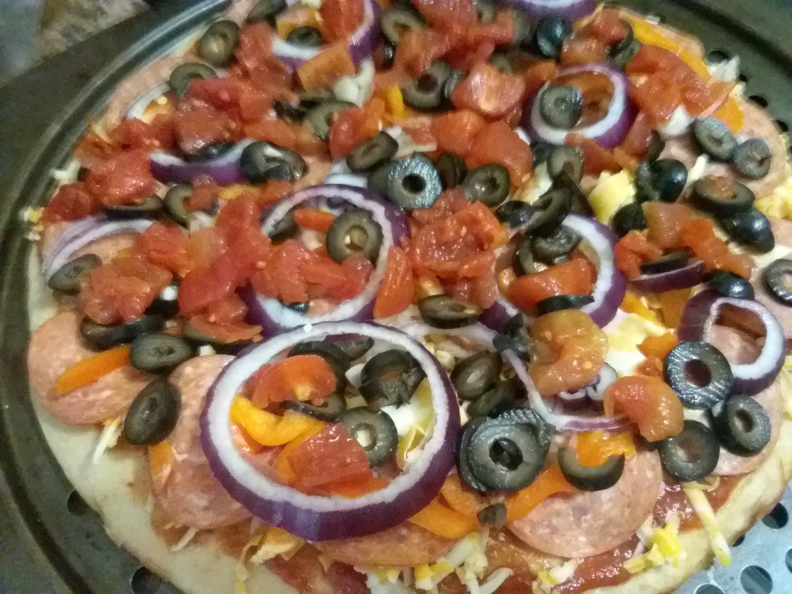 Pepperoni pizza with black olives