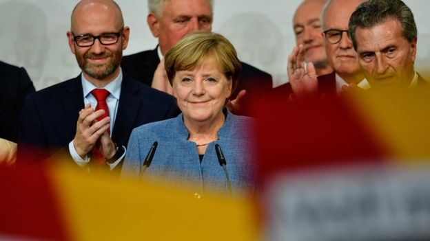 Germany election: Merkel wins fourth term, exit polls say