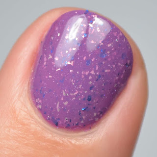 purple nail polish with flakies