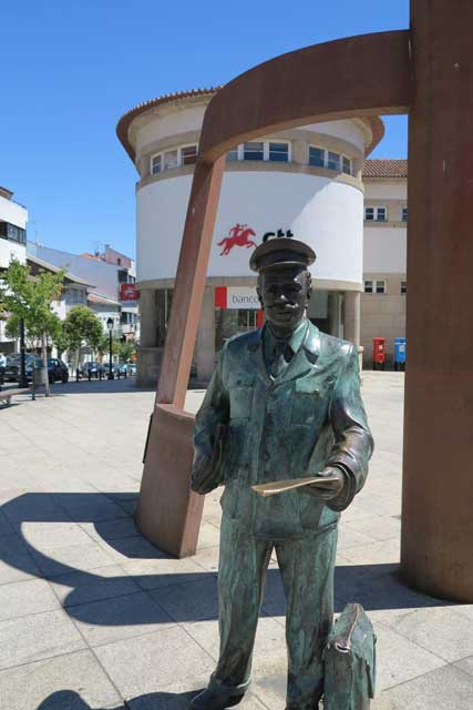 Statue of a postal worker outside the main post office in Bragança.