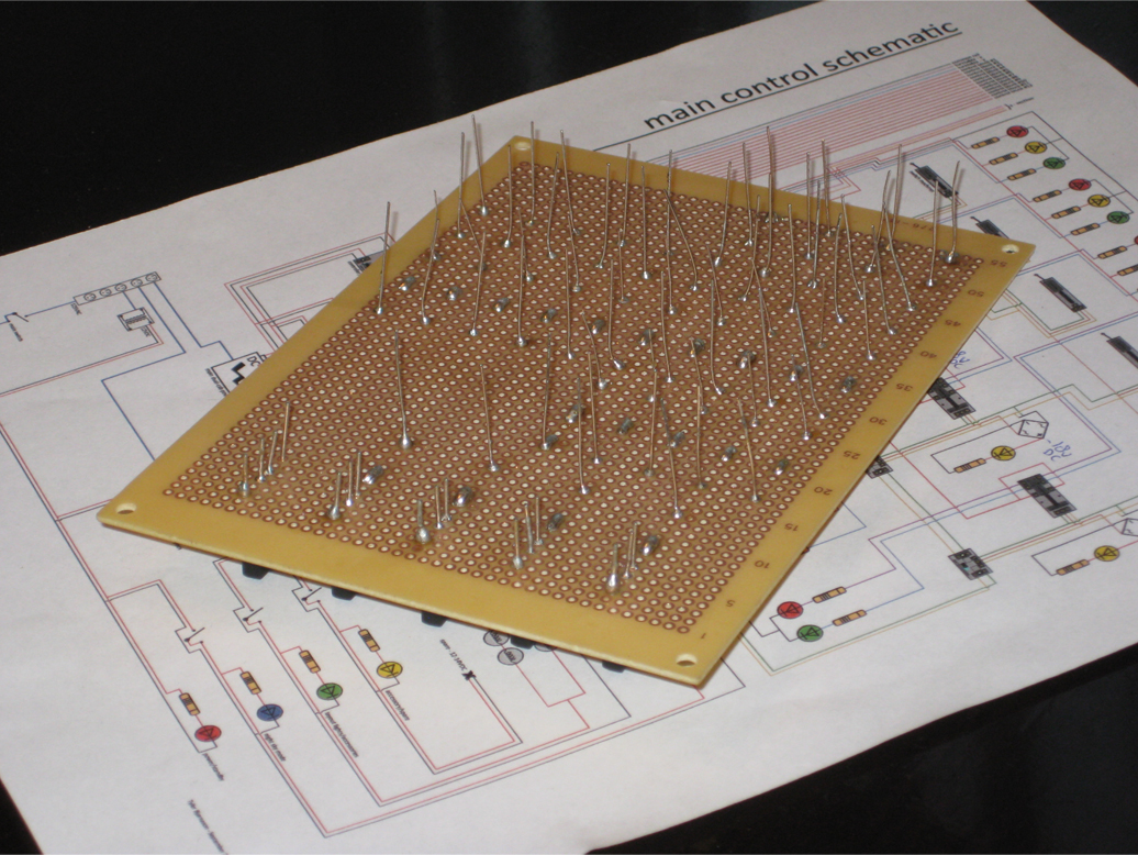 Underside of a blank PC board with soldered resistors and bridge rectifiers