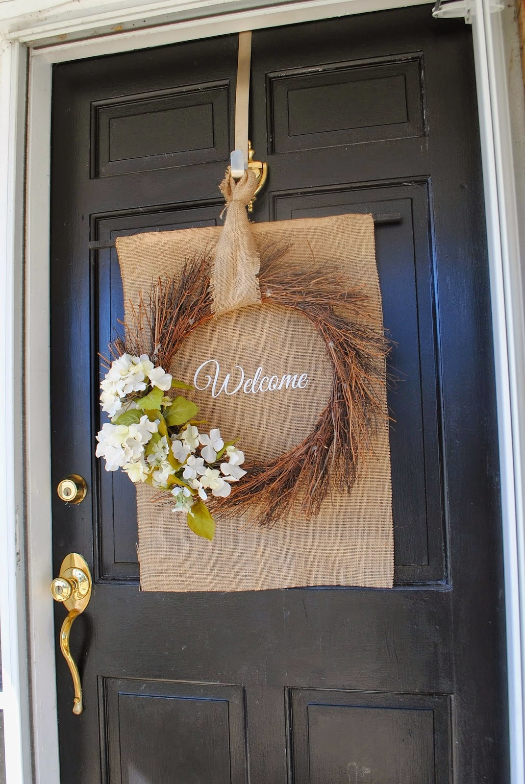 A spring wreath on a front door.