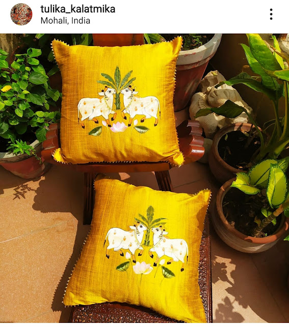Mustard yellow raw silk cushion covers with Pichwai paintings on the,