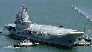 Shandong is a first-generation Chinese aircraft carrier. Shandong was built in 2017 by Dalian Shipbuilding Industry. In development, Shandong was originally designed as a 001A type carrier, but was initially completed as a 002 type.  It measures about 315 metres (1,033 ft) long, with a displacement of about 55,000 tonnes.